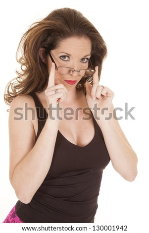 A woman is wearing glasses touching them with her hands. - stock photo