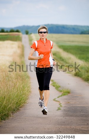 A woman jogging cross country