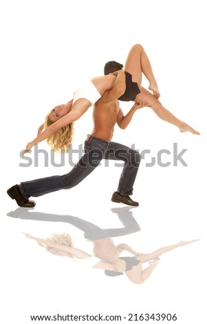 A woman leaning back while her man is lifting her in a dance pose - stock photo