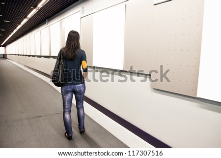 A woman looking at the pictures - stock photo