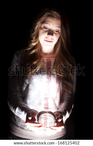 A woman looking down at her crystal ball. - stock photo
