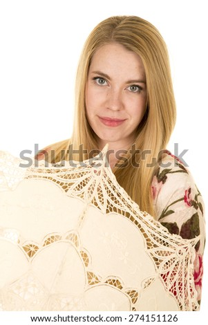 a woman looking over the umbrella with a small smile. - stock photo