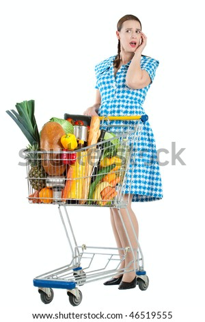 A woman looking puzzled while choosing whilst shopping. - stock photo