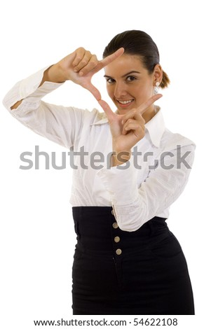 A woman looking through her fingers finding the angle - stock photo