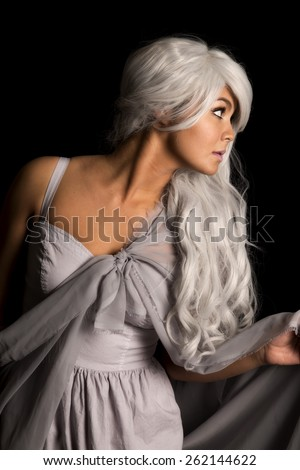a woman looking to the side in her costume. - stock photo