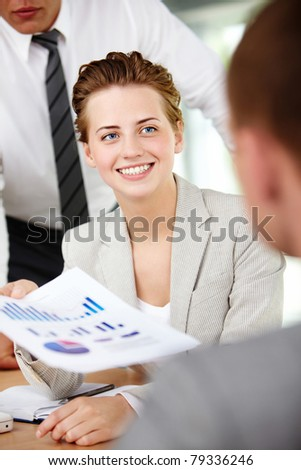 A woman manager looking at business partner during conversation - stock photo
