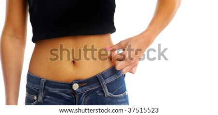 A woman measuring the thickness of her fat. - stock photo