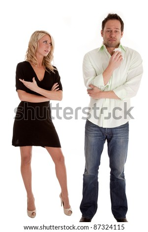 A woman not happy that her man is crying in his tissue. - stock photo