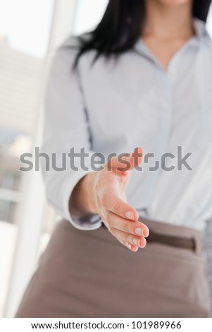 A woman offering her hand to shake - stock photo