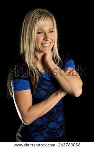 a woman on a black background with a big smile on her face. - stock photo