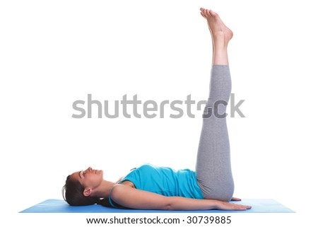 A woman on an exercising mat in a raised legs position, isolated on a white background. - stock photo