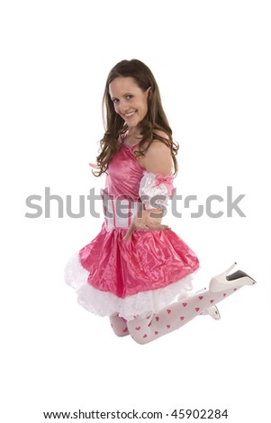 A woman on her knees in a valentine's out fit with a smile and some attitude.
