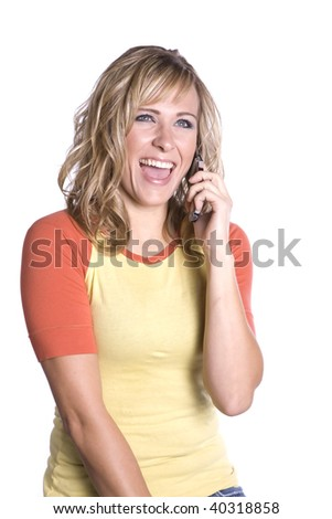 A woman on her phone laughing about something that was said on the phone.