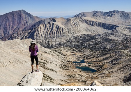 a woman on top of Mount Julius Caesar looks down into Granite Park far below