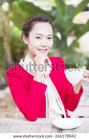 A woman on vacation, I drink coffee. Natural background, hot coffee. - stock photo