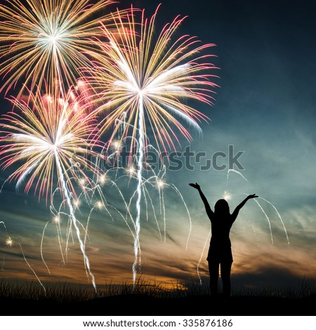 A Woman open arms, watching the beautiful holiday fireworks - stock photo