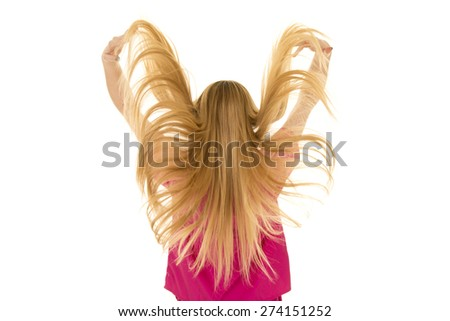 a woman playing with her hair lifting her hair. - stock photo