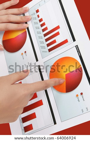 A woman pointing at a colorful chart graph - stock photo