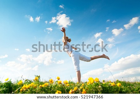 a woman practicing yoga outdoor