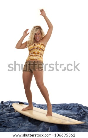 A woman pretending to be surfing on her blue water with an excited expression on her face. - stock photo