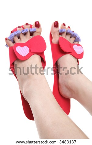 A woman pretty feet getting a pedicure - stock photo
