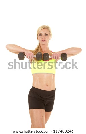 A woman pulling up on her weights with a serious expression.