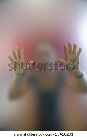 A woman pushing a glass door to open - stock photo