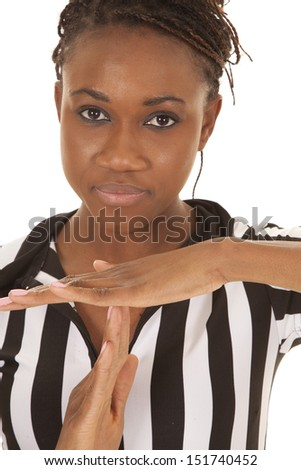 A woman referee calling a time out with a serious expression on her face. - stock photo