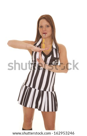 A woman referee is signaling a time out call. - stock photo