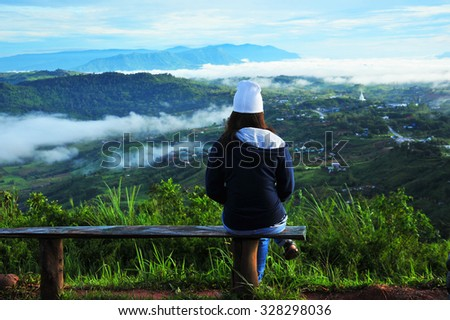 A Woman Relax on The Top of The Hill - stock photo