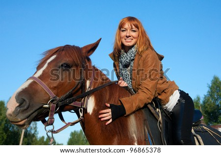 A woman riding a horse in sport