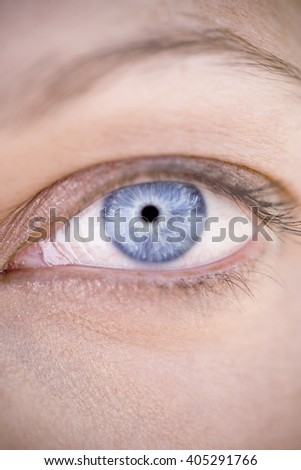 A woman's blue eye with makeup