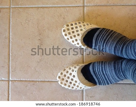 a woman's feet with slippers   - stock photo