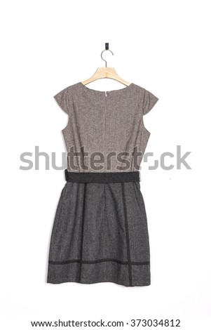 A woman's grey(brown) one piece with hanger on the wall isolated white.