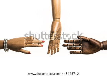 A woman's hand and one hand of black man meet. A white hand opposes. On white background. With copy text. - stock photo