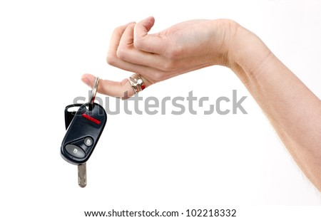 A woman's hand holds car keys and electronic door unlock - stock photo
