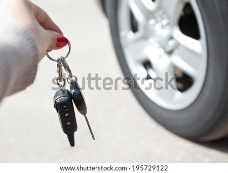 A woman's hand with a key from the machine - stock photo