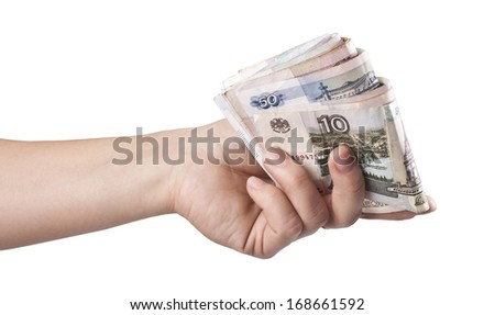 A woman's hand with money - stock photo