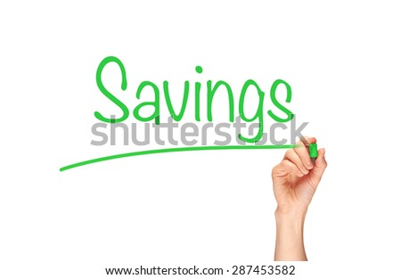 A woman's hand writing the word, Savings, on a clear screen. - stock photo