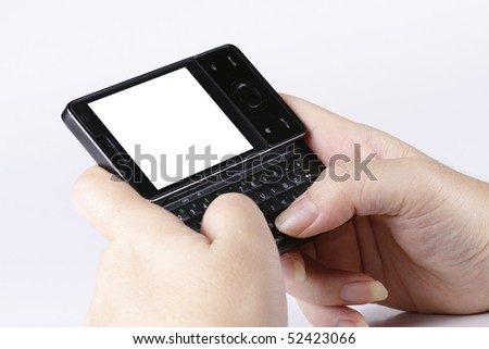 A woman's hands operating a smart phone with QWERTY keyboard. Clipping paths included for LCD screen. - stock photo