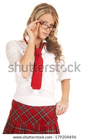 A woman schoolgirl in a red skirt holding her glasses. - stock photo