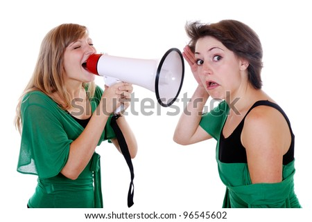 a woman screams to another woman through a megaphone