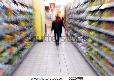 A woman shopping with zooming blur - stock photo