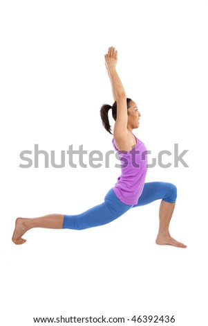A woman showing her flexibility and strength by doing a yoga move.