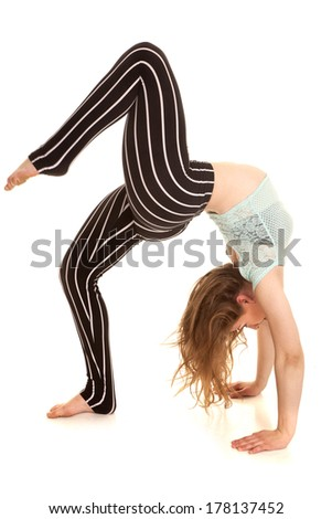 A woman showing her flexibility bending.