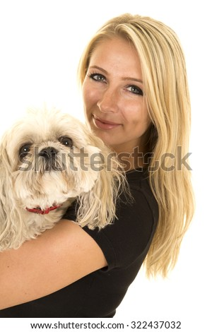 a woman showing her love for her Maltese puppy. - stock photo