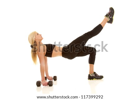a woman showing her strength by lifting her leg up