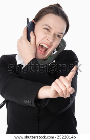 A woman simulating aggressive financial trading activity on a white background. - stock photo