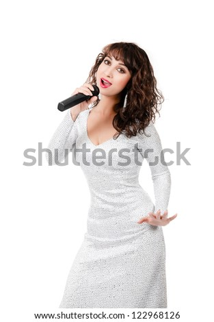 A woman sings on a white background redhead - stock photo