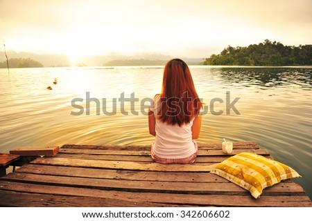 A Woman Sit on The Wooden Bridge  - stock photo